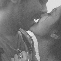 smiling between kisses