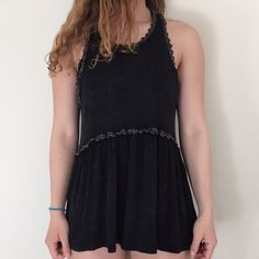 Never worn,brand new& comfortable for warm weather Blackish discolored (POL style). Awesome shirt it doesn't go with my clothes. POL Tops Tank Tops