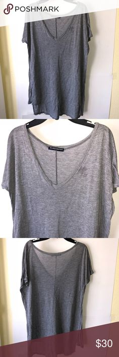 Brandy Melville Top You are looking at a beautiful Brandy Melville top   Measurements  Pit to pit 22in Length 25 in  Wt 6  Smoke free pet free home  No rips tears or holes   Please ask if you have any questions and please check out other items in my store. Thank you for shopping with Bunch of Styles Brandy Melville Tops Tees - Short Sleeve