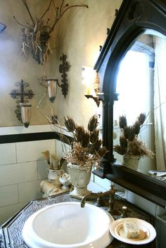 Like the mirror and light sconces.  I also like the sink.