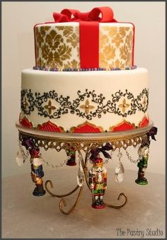 Christmas Nutcracker themed wedding cake in a palette of red and gold. Absolutely gorgeous!