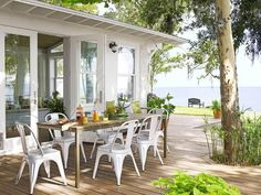 Turning a Shabby Shack into a Family Beach House Gorgeous outdoor eating area (beach house makeover in HGTV magazine via Hooked on Houses) The post Turning a Shabby Shack into a Family Beach House appeared first on Outdoor Diy. Beach Cottage Style, Coastal Cottage, Beach House Decor, Coastal Style, Coastal Living, Lakeside Living, Coastal Farmhouse, Modern Coastal, Outdoor Rooms