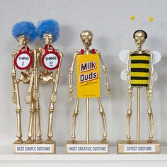 DIY Costume Award Trophies....for your Halloween party! Decorate your skeleton according to the contest category.