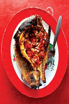 Pescado Encarcelado: This clean, flavorful preparation of whole fish stuffed with pico de gallo preserves all the fish's natural juices.
