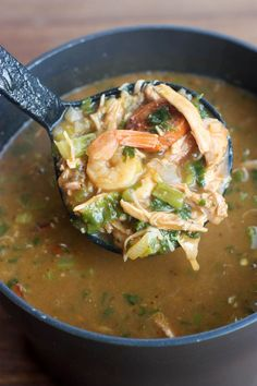A large pot filled with a New Orleans Style Gumbo soup mixture and a ladle holding a scoop of the gumbo. Louisiana Recipes, Cajun Recipes, Southern Recipes, Seafood Recipes, Soup Recipes, Chicken Recipes, Cooking Recipes, Haitian Recipes, Gumbo Recipes
