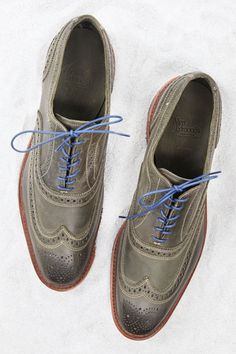 Tip: If technicolor's definitely not your thing — and may never be — olive green leather is a strong entry point. Especially when it's paired with the blue laces that come with these, but can be easily replaced if it throws your conservatism off too much. Unlined lace-up leather wingtip ($250) by Allen Edmonds, allenedmonds.com.   - Esquire.com