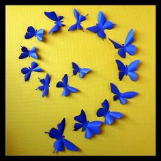 3D Wall Butterflies  15 Celestial Blue  Butterfly by BugsLoft, $20.00.......OR you can spend $6 on cardstock of your choice (I did 3 different colors of glitter) and make about 60 of them yourself.