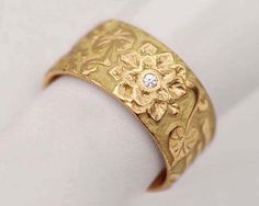 Hey, I found this really awesome Etsy listing at https://www.etsy.com/listing/188402657/diamond-and-lotus-blossom-band-18k