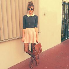 Collar sweater, pleated skirt, heart tights + satchel + high messy bun, so cute! Wish I were young enough to wear it!