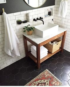 Black tile floor and love the sink