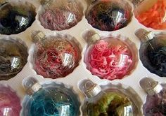 Yarn-filled, glass ornaments. This is an easy way to get rid of extra yarn scraps!
