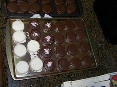 Home made chocolate and white chocolate peppermint covered oreos :)