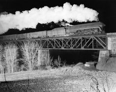 O Winston Link photo of N passenger line. Sometimes he would place his car in the shot, in this case under the bridge