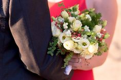 Ivory lisianthus, white berries, red hypericum, and mixed greenery