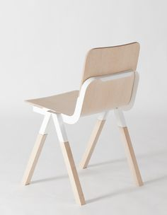 Handle Chair is a minimalist chair designed by Denmark-based designer Peter Johansen. The seat is constructed of solid ash, pressed ash veneer, powder-coated sheet steel. The concept was to create a beautiful chair that can be easily shipped in a small container. The chair is stackable, and has a ledge at the back of its seat for easy handling. (15)