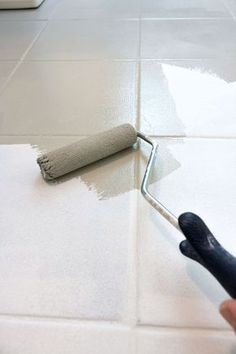 How to paint ceramic tile floor - this post gives all the details of how to get the job done! Small roller and paint brush are used to apply the paint!