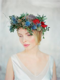 One of the most beautiful bridal crowns ever. With feathers & pops of blue & red. LOVE! flower wreath for wedding