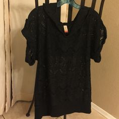 Black Net Style hooded shirt Gently used Black pullover style shirt with a hood. Wide short sleeves with big buttons. Big pocket in the front. No rips, snags or tears. Size 11-13 Tops Tunics