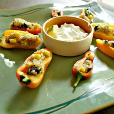 A flavorful black bean and lime southwestern quinoa salad is stuffed into mini sweet peppers for a perfect hand-help appetizer. It is made complete with a lime sour cream dipping sauce.