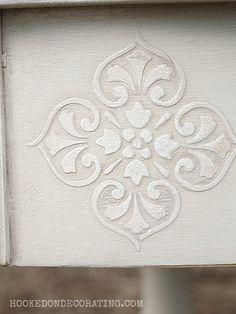 Raised stencils on wood furniture.