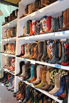 cowboy boots. I WANT A PAIR OF COWBOY BOOTS FOR EVERY OUTFIT!! And ps I'd die if this was my closet...