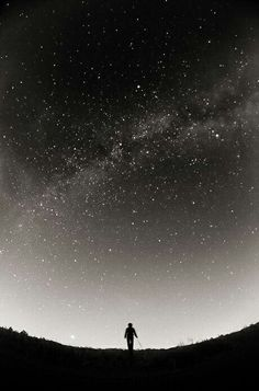 The NEGATIVE SPACE allows DOMINANCE in this photo because the photographer wants us to focus on the silhouettes of the person and the hill. The galaxy and the sky in the background is the SUBORDINATE subject. White Photography, Landscape Photography, Nature Photography, Alone Photography, Beautiful Sky, Beautiful World, Ciel Nocturne, Sky Full Of Stars, Star Sky