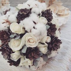 We love this gorgeous winter bridal bouquet with roses, pine cones and cotton. What do you think? Winter Bridal Bouquets, Thessaloniki, Pine Cones, Our Love, Floral Wreath, Roses, Wreaths, Cotton, Instagram