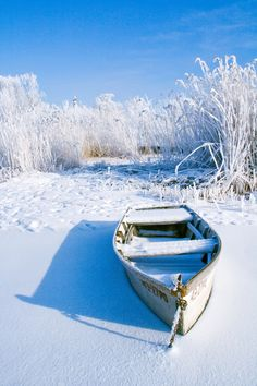 snowy beach..another great boat left in the cold