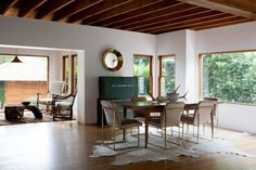 Similar light;  making oak wood floors work with wood furniture; this project would have to be more classical and less modernist