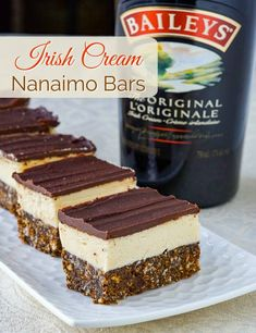 Irish Cream Nanaimo Bars - could this be Bailey's at its best? - - Irish Cream Nanaimo Bars - one of Canada's favourite tipples meets one of the country's iconic cookie bar treats. An absolute must-have for the Holiday freezer! Köstliche Desserts, Holiday Desserts, Holiday Baking, Christmas Baking, Delicious Desserts, Holiday Bars, Irish Desserts, Christmas Treats, Dessert Recipes