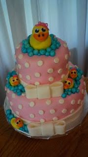 This was a baby shower cake I made. The ducks are all hand made out of fondant and so are the sparkling bubbles. This was one of my favorite cakes I've made!