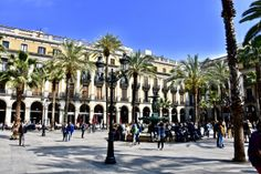 Placa Reial - just off La Rambla - in Barcelona, Spain. Read about our time spent in Barcelona on our site!  Placa Reial Las Ramblas Barcelona Spain European Squares Europe World Travel Wanderlust Barri Gotic