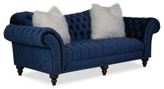 Irresistible to Touch. Fanciful with opulent details, the Brittney sofa turns vintage charm into trendsetting appeal. Lovers of whimsical tufting and lavish hand-applied nailhead trim will be drawn to the character this piece exudes. Take a seat and enjoy the soft, navy blue upholstery and beautiful detailing, from scrolled arms to turned, carved wood legs. Perfect for traditional décor schemes, this Victorian-inspired sofa embraces today's furniture trends with faux fur toss pillows and a…