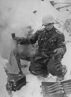 German soldier firing mortar, Leningrad front 1943.