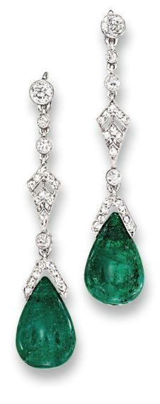 A PAIR OF BELLE EPOQUE EMERALD AND DIAMOND EAR PENDANTS, BY CARTIER  Each suspending an emerald drop to the rose-cut diamond cap and kite-shaped panel with diamond collet connecting links and circular-cut diamond surmount, circa 1915, 4.3 cm long, in fitted cream leather Cartier case