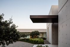 Concrete and glass surfaces extend from inside to outside at Israeli house by Studio de Lange