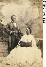 Lady Sarah Forbes Bonetta, a ward of Queen Victoria, (her daughter Victoria was the god daughter of Queen Victoria) shortly after her arranged (by Queen VIctoria) marriage, with her new husband a rich merchant. She was always at court and was known for her intelligence and wit and spoke many languages. Her family were African royalty killed in a tribal slave war when she was a child. She was brought to Britain as a child to save her life,as she was also going to be executed. BIDDY CRAFT