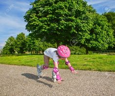 Preschool Girl With Inline Roller Skates On, Falling Down Stock Photo, Picture And Royalty Free Image. Image 21427936.