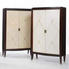 Pair of French Art Deco Cabinets mahogany and parchment with gilt tooling, circa 1940.