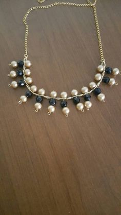 Check out this item in my Etsy shop https://www.etsy.com/listing/485152895/black-and-gold-bead-necklace-chain