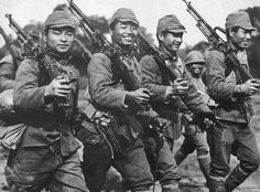Japanese army soldiers with captured guns.