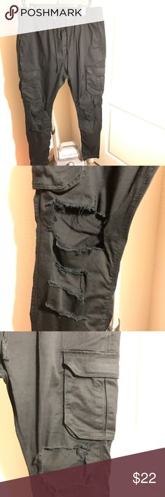 Divided by H&M cotton twill cargo pants Worn a few times but kept in great condition. Custom distressing at the knees and slightly below. Divided (H&M) cargo cotton twill pants in black, size 36, (equivalent to an XL). H&M Pants Cargo