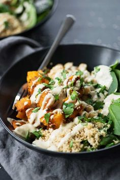 Butternut Squash Tahini Buddha Bowls! Roasted squash, spinach, couscous, beans and homemade goddess dressing. Vegan. | www.delishknowledge.com