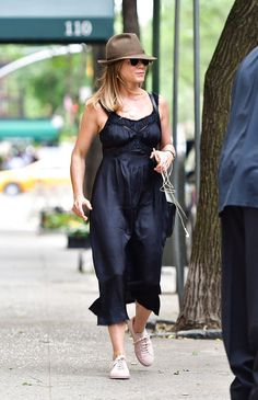 Pin for Later: Jennifer Aniston Just Pulled the Shoe Switch-Up of the Summer Jen Wearing Her Slip Dress With Sneakers