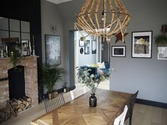 The open plan seating area from the kitchen which has the doors leading to the other rooms downstairs off it. Small Kitchen Diner, Open Plan Kitchen, Kitchen Chandelier, Rustic Chandelier, Home Decor Kitchen, Rustic Kitchen, Kitchen Modern, Room Kitchen, Kitchen Ideas