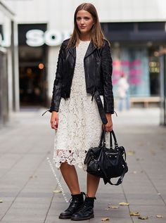 STREET STYLE : Black biker jacket with white cut-out lace dress, Dr. Martens boots and Balenciaga bag...