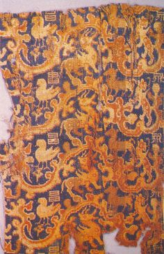 Textile fragment from Loulan, China. Loulan also called Krorän or Kroraina, was an ancient kingdom based around an important oasis city along the Silk Road.