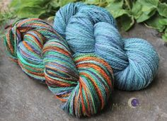 SAMHAIN SKIES is a beautiful combination of stormy skies and pumpkin fields--burnt oranges, greys, slate, teal, brown, green. Semisolid is a lovely slate/teal mix. http://www.mosaicmoon.com/item_167/Samhain-Skies-Mtn-Worsted-or-Bulky-4-oz-skeins-with-matching-semisolid.htm