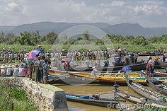 People and Rowers at the boats on Inle Lake during the feast of Buddha in Myanmar (Burma)  http://www.veloasia.com/country/myanmar/festival/myanmar_puang_daw_u_festival.htm