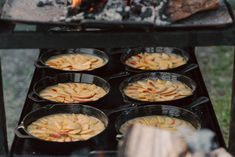 Nothing compares to the smell of summer peaches slowly cooking in a butter rich cornmeal batter, over the fire.